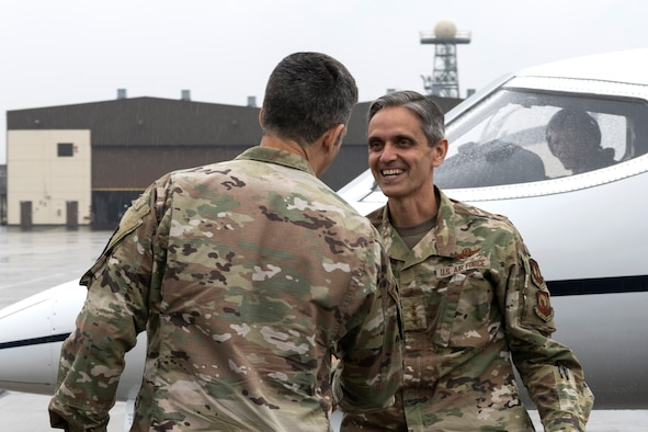 U.S. Air Force Col. William McKibban, 52nd Fighter Wing vice commander, greets U.S. Air Force Lt. Gen. Steven Basham, U.S. Air Forces in Europe and Air Forces Africa deputy commander.