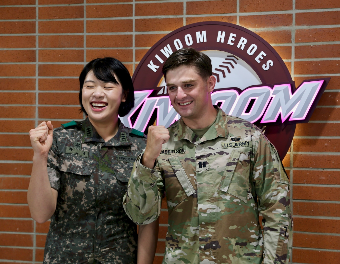 U.S. Army Capt. Miles Garbielson and ROK Army Capt. Ha Neul prepare for their participation in the ceremonial first pitch before South Korea's professional baseball game between the Kiwoom Heroes and the Kia Tigers at Gecheok Sky Dome on June 25, 2021.