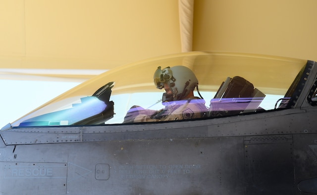 """U.S. Air Force Brig. Gen. Robert Davis, 378th Air Expeditionary Wing commander, prepares for his flight on a U.S. Air Force F-16 Fighting Falcon, Prince Sultan Air Base, Kingdom of Saudi Arabia, June 20, 2021. Davis, a trained fighter pilot, flew a sortie with the 157th """"Swamp Fox"""" Expeditionary Fighter Squadron, currently deployed to PSAB to bolster defensive capabilities against potential threats in the region. (U.S. Air Force photo by Senior Airman Samuel Earick)"""