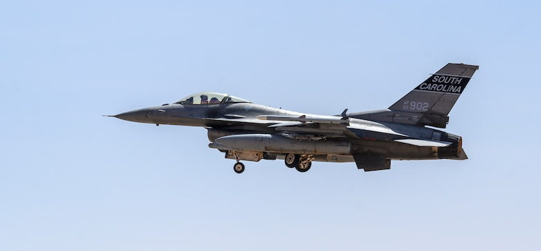 """U.S. Air Force Brig. Gen. Robert Davis, 378th Air Expeditionary Wing commander, takes-off in a U.S. Air Force F-16 Fighting Falcon from Prince Sultan Air Base, Kingdom of Saudi Arabia, June 20, 2021. Davis, a trained fighter pilot, flew a sortie with the 157th """"Swamp Fox"""" Expeditionary Fighter Squadron, currently deployed to PSAB to bolster defensive capabilities against potential threats in the region. (U.S. Air Force photo by Senior Airman Samuel Earick)"""