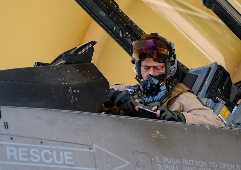 """U.S. Air Force Brig. Gen. Robert Davis, 378th Air Expeditionary Wing commander, prepares for his flight in a U.S. Air Force F-16 Fighting Falcon, Prince Sultan Air Base, Kingdom of Saudi Arabia, June 20, 2021. Davis, a trained fighter pilot, flew a sortie with the 157th """"Swamp Fox"""" Expeditionary Fighter Squadron, currently deployed to PSAB to bolster defensive capabilities against potential threats in the region. (U.S. Air Force photo by Senior Airman Samuel Earick)"""