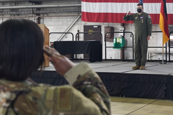 U.S. Air Force Lt. Col. Winton P.D. Laslie, the outgoing 52nd Operational Medical Readiness Squadron commander, returns a final salute during the 52nd OMRS change of command ceremony June 18, 2021, on Spangdahlem Air Base, Germany.