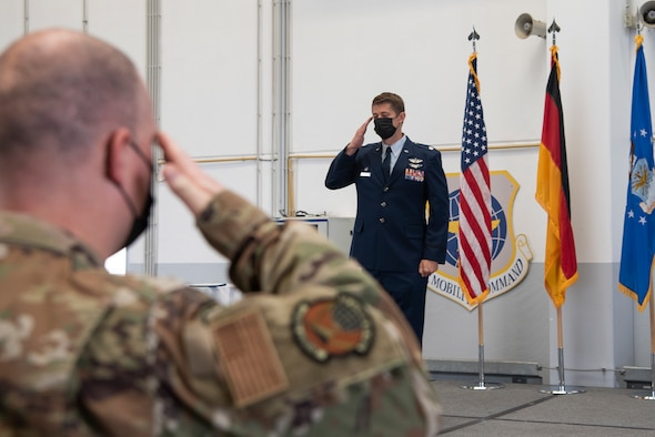 U.S. Air Force Lt. Col. Joshua Coakley, the new 726th Air Mobility Squadron commander, returns the first salute to the 726th AMS