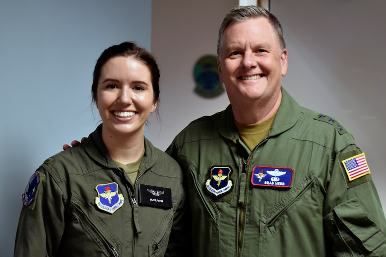 U.S. Air Force 2nd Lt. Alana Daum stands with Lt. Gen. Brad Webb, Air Education and Training Command commander, following her graduation from Specialized Undergraduate Helicopter Pilot Training, Class 21-05, at Fort Rucker, Alabama, June 22, 2021. Seven officers received their pilot's wings, becoming the first Air Force officers to earn their wings from a helicopter-only syllabus since 1993. HTN is one initiative of the Pilot Training Transformation effort and was developed to create quality pilots, while increasing the Air Force's overall pilot production. The HTN graduates began their training August 2020 as part of a small group who went directly to Fort Rucker for TH-1 training. HTN is one aspect of the AETC Pilot Training Transformation efforts that include Undergraduate Pilot Training 2.5, Accelerated Path to Wings, Remote SIM Instruction, Civil Path to Wings and Alternate Path to Wings.