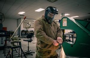 A maintenance airman welds.