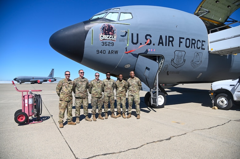 The crew chiefs assigned to the 940th Air Refueling Wing's KC-135 Stratotanker, Grizzly, stand with leadership from the wing, Fourth Air Force and Air Force Reserve Command June 13, 2021, at Beale Air Force Base, California.