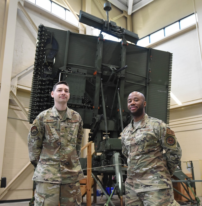 U.S. Air Force Tech. Sgts. Joshua Barich and Staff Sgt. Kevin Boyd, 334th Training Squadron Command and Control Battle Management Operations apprentice course instructors, pose for a photo inside Matero Hall at Keesler Air Force Base, Mississippi, June 24, 2021. The radar is used by C2BMOs to provide safe use of the airspace by tracking aircraft, planning missions, and monitoring the skies. (U.S. Air Force photo by Airman 1st Class Jasmine Galloway)