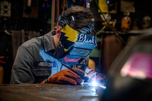 210617-N-IK871-2016 ATLANTIC OCEAN (June 17, 2021) Fireman Anderson practices tig welding using a tig torch aboard the Wasp-class amphibious assault ship USS Kearsarge (LHD 3) June 17, 2021. Anderson was the Commander Naval Surface Force Atlantic Surface Line Week welding competition winner by showcasing skills as a hull technician by welding a command representation piece using repair equipment on board Kearsarge. (U.S. Navy photo by Mass Communication Specialist Class 3rd Nick Boris)