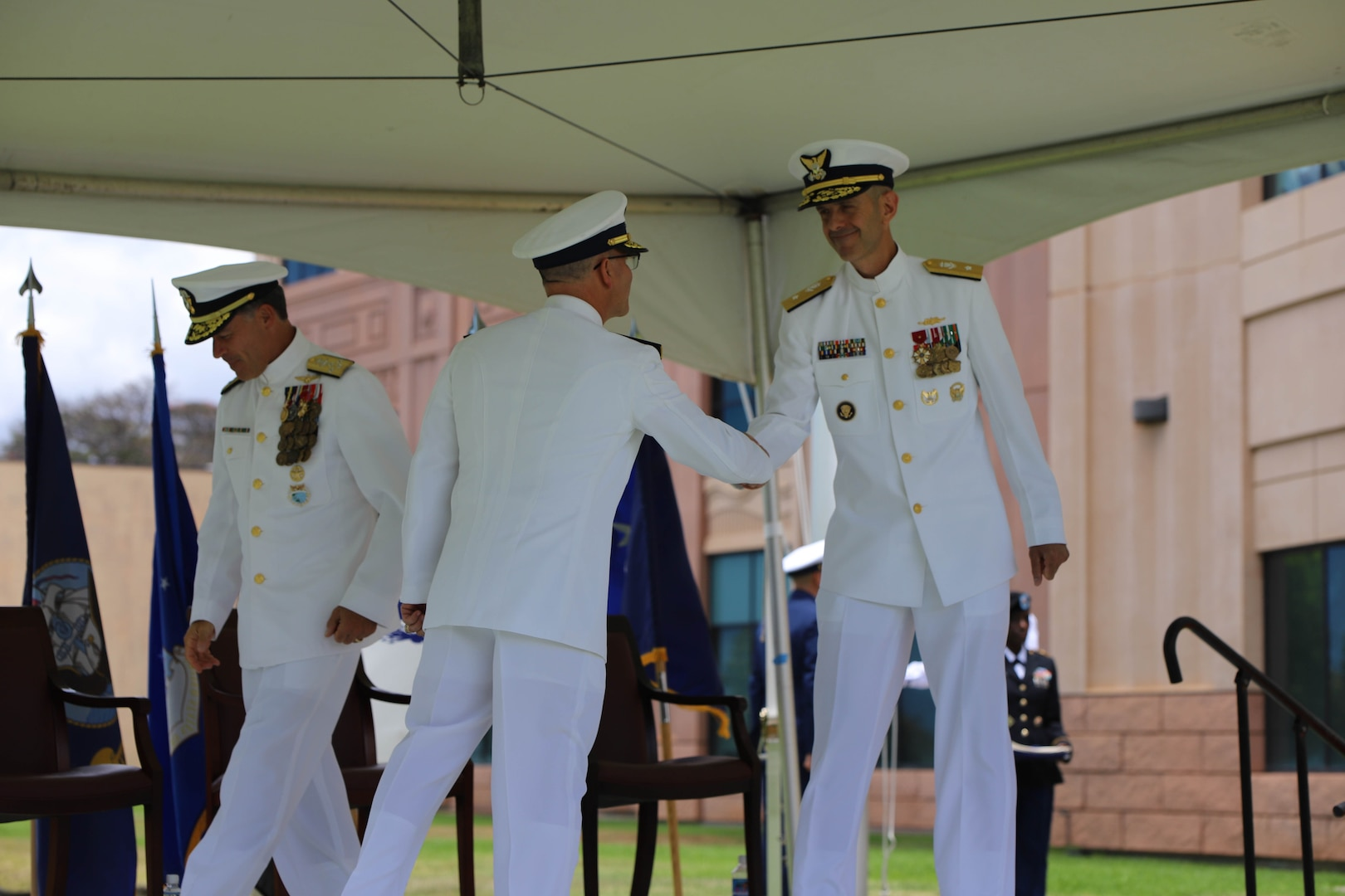 Camp H.M. Smith, Hawaii (June 25, 2021) Rear Admiral Charles Fosse, left, relieves Rear Admiral Robert Hayes, right, as Director of Joint Interagency Task Force West (JIATF West). Fosse becomes the 19th director of JIATF West, the executive agent for counter narcotics within the Indo-Pacific Command (INDOPACOM) area of operation.  As the JIATF West director, he is charged with leading more than 140 Soldiers, Sailors, Marines, Airmen, Coast Guardsmen, and Department of Defense civilians and is responsible for assisting U.S. law enforcement efforts in countering narcotics and the flow of illicit chemicals bound for the Western Hemisphere within the Indo-Pacific.