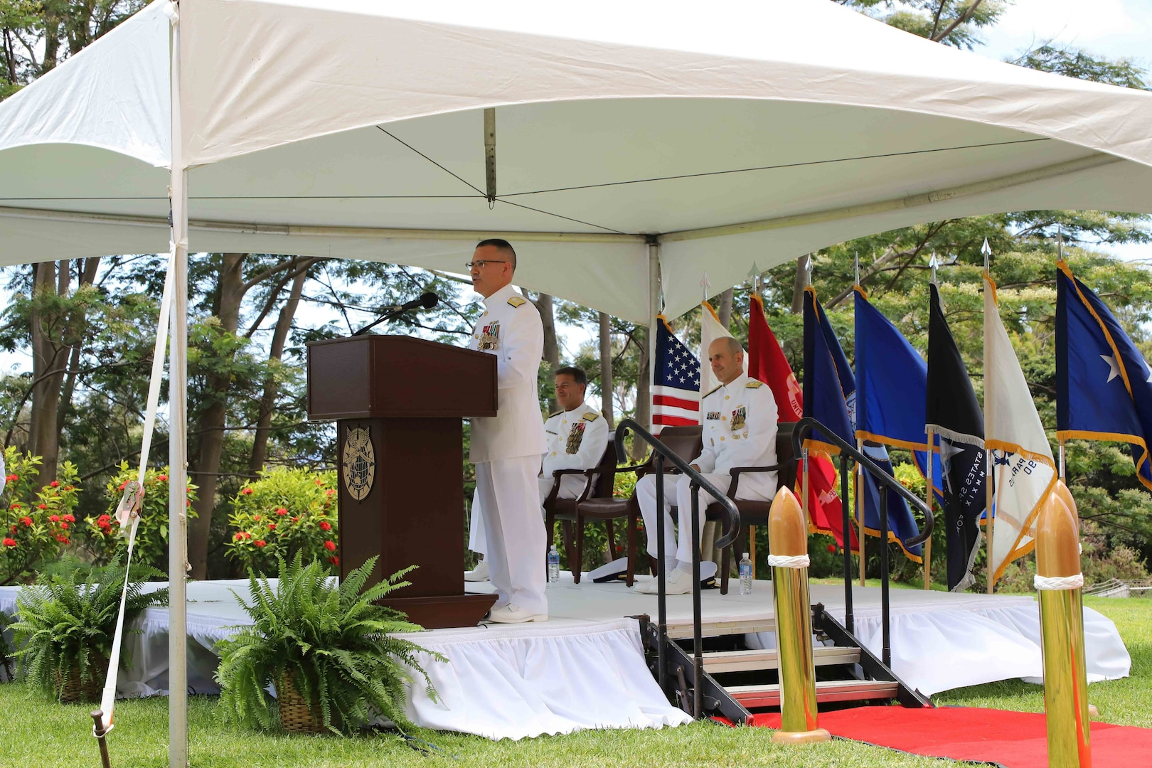 Camp H.M. Smith, Hawaii (June 25 2021) Rear Admiral Hayes delivers remarks during the change of ceremony for Joint Interagency Task Force West (JIATF West) where he relinquished command to Rear Charles Admiral Fosse.