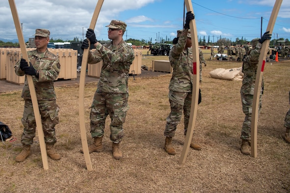 624th Regional Support Group Reserve Citizen Airmen break down Triple S construction tents after a Total Force Integration (TFI) exercise at Schofield Barracks, Hawaii. TFI is a blend of active, Guard, and Reserve personnel working together to accomplish the mission.