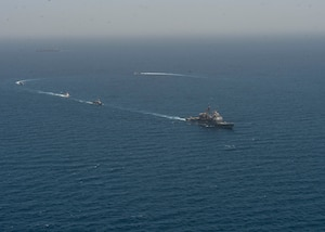 210608-N-RG587-1336 ARABIAN GULF (June 8, 2021) Guided-missile cruiser USS Vella Gulf (CG 72), patrol coastal ship USS Thunderbolt (PC 12), Coast Guard patrol boat USCGC Monomoy (WPB 1326), and Kuwait Navy patrol boats KNS Istiqlal (P5702) and KNS Al-Garoh (P3725), operate in formation during Eager Defender 21 in the Arabian Gulf, June 8. Eager Defender 21 is the capstone in a series of bilateral exercises between Kuwait and U.S. naval forces, focused on enhancing mutual capabilities and interoperability in maritime security operations. (U.S. Navy photo by Mass Communication Specialist 2nd Class Dean M. Cates)