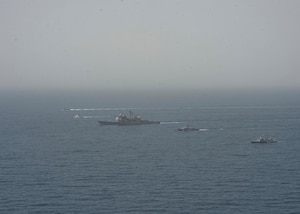 210608-N-RG587-1726 ARABIAN GULF (June 8, 2021) Guided-missile cruiser USS Vella Gulf (CG 72), patrol coastal ship USS Thunderbolt (PC 12), Coast Guard patrol boat USCGC Monomoy (WPB 1326), and Kuwait Navy patrol boats KNS Istiqlal (P5702) and KNS Al-Garoh (P3725), operate in formation during Eager Defender 21 in the Arabian Gulf, June 8. Eager Defender 21 is the capstone in a series of bilateral exercises between Kuwait and U.S. naval forces, focused on enhancing mutual capabilities and interoperability in maritime security operations. (U.S. Navy photo by Mass Communication Specialist 2nd Class Dean M. Cates)