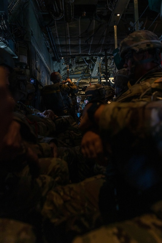 U.S Army Soldiers with 301st Tactical Psychological Operations, PSYOP, Company (Airborne),14th PSYOP Battalion, 7th PSYOP Group, receive instruction during a KC-130 Hercules static-line jump exercise at Naval Base Coronado, California, June 11, 2021. The 301st TCP invited I Marine Expeditionary Force Information Group PSYOP Marines to observe jump training before attending the U.S. Army Airborne school. Gaining jump qualifications enables I MIG to effectively integrate and support I Marine Expeditionary Force information operations in forward deployed environments.