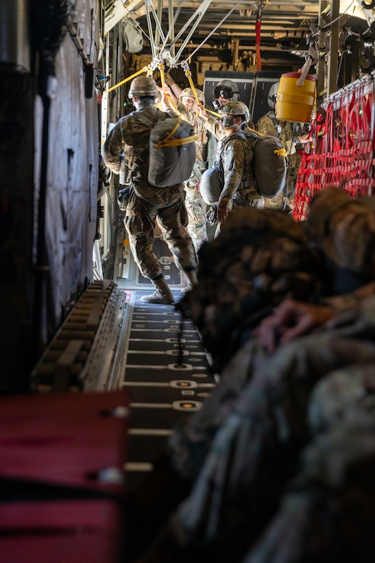U.S. Army Soldiers with 301st Tactical Psychological Operations, PSYOP, Company (Airborne),14th PSYOP Battalion, 7th PSYOP Group, jump out of a U.S. Air Force KC-130 Hercules during a static-line jump exercise at Naval Base Coronado, California, June 11, 2021. The 301st TCP invited I Marine Expeditionary Force Information Group PSYOP Marines to observe jump training before attending the U.S. Army Airborne school. Gaining jump qualifications enables I MIG to effectively integrate and support I Marine Expeditionary Force information operations in forward deployed environments.