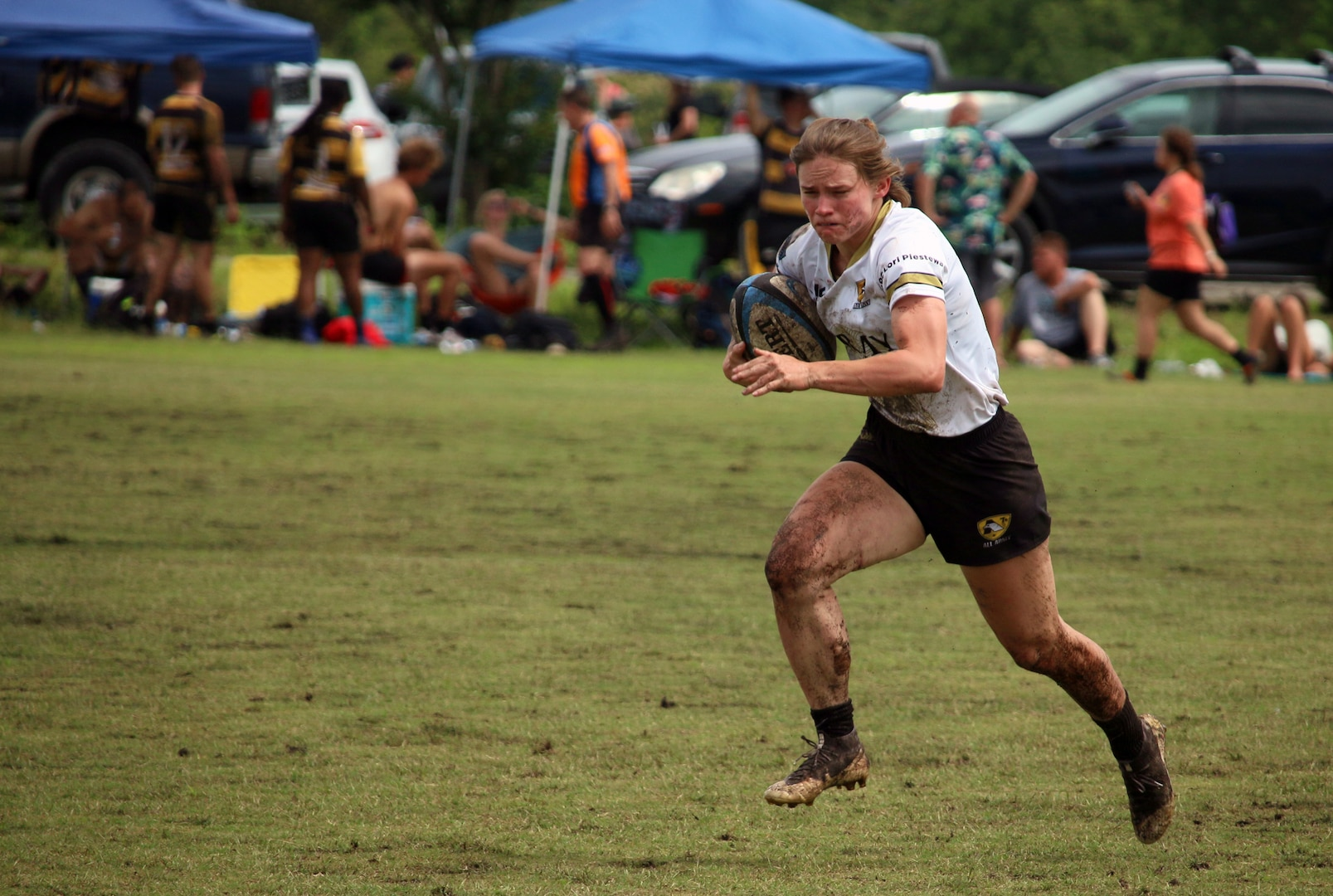 Army 2nd lt. Samantha Sullivan of Fort Carson, Colo. drives to the try zone against the Marine Corps during the 2021 Armed Forces Rugby Championship held in conjunction with the 2021 Cape Fear Rugby Sevens Tournament, held from 24-28 June.  Service members from the Army, Marine Corps, Navy, Air Force (with Space Force personnel) and Coast Guard battle it out for gold.  (Department of Defense Photo, Released)
