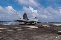 """An F/A-18E Super Hornet, attached to the """"Sunliners"""" of Strike Fighter Squadron (VFA) 81, lands on the deck of the Nimitz-class aircraft carrier USS Harry S. Truman (CVN 75) during Group Sail."""