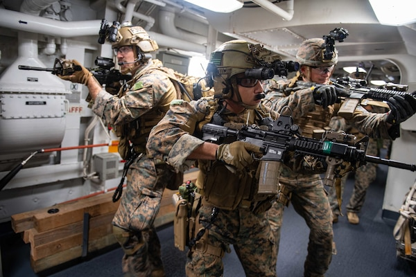 210614-N-XB010-1020 EAST CHINA SEA (June 14, 2021) Marines attached to the 31st Marine Expeditionary Unit (MEU) search USS New Orleans (LPD 18) during a Maritime Raid Force training evolution with USS Germantown (LSD 42). New Orleans, part of the America Amphibious Ready Group, along with the 31st Marine Expeditionary Unit, is operating in the U.S. 7th Fleet area of responsibility to enhance interoperability with allies and partners and serve as a ready response force to defend peace and stability in the Indo-Pacific region. (U.S. Navy photo by Mass Communication Specialist 2nd Class Desmond Parks)