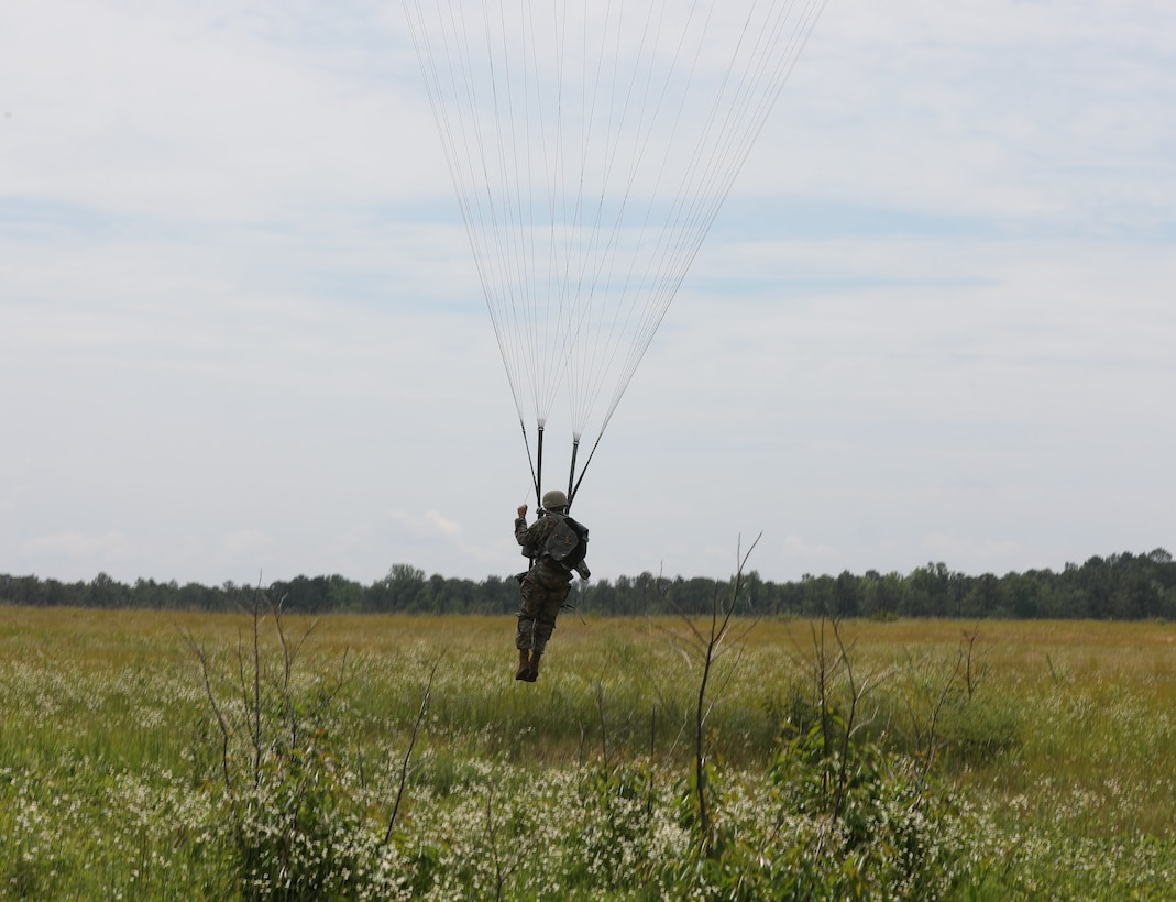 A U.S. Army Reserve paratrooper with the U.S. Army Civil Affairs and Psychological Operations Command (Airborne) navigates to a landing during nontactical airborne operations at Saint Mere Eglise drop zone, Fort Bragg, N.C., June 5, 2021. USACAPOC(A) jumpmasters worked with Capt. Ignacio Rios, a Chilean jumpmaster assigned to the 1st Special Warfare Training Group(A), U.S. Army John F. Kennedy Special Warfare Center and School (USAJFKSWCS). Paratroopers jumping during the airborne operations were eligible to earn foreign wings.