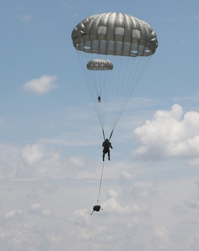 U.S. Army Reserve paratroopers with the U.S. Army Civil Affairs and Psychological Operations Command (Airborne) navigate to a landing during nontactical airborne operations at Saint Mere Eglise drop zone, Fort Bragg, N.C., June 5, 2021. USACAPOC(A) jumpmasters worked with Capt. Ignacio Rios, a Chilean jumpmaster assigned to the 1st Special Warfare Training Group(A), U.S. Army John F. Kennedy Special Warfare Center and School (USAJFKSWCS). Paratroopers jumping during the airborne operations were eligible to earn foreign wings.