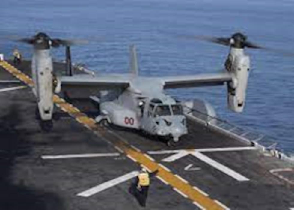 Osprey landing on a ship