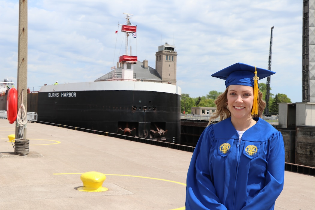 U.S. Army Corps of Engineers student trainee Sophie McConkey stands in front of the Burns Harbor as it transits the Poe Lock in Sault Ste. Marie, Mich. on June 3, 2021. McConkey is an Industrial Hygienist-Intern with the Soo Area Office and is heading to medical school in the fall of 2021.