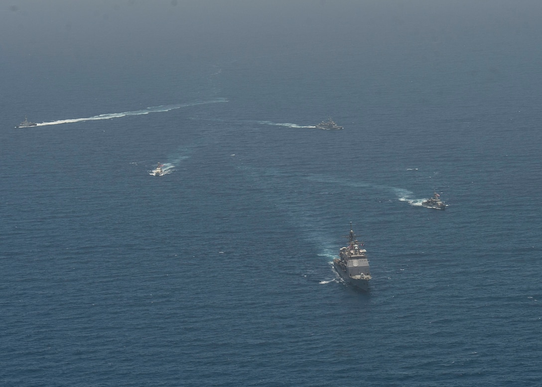 ARABIAN GULF (June 8, 2021) Guided-missile cruiser USS Vella Gulf (CG 72), patrol coastal ship USS Thunderbolt (PC 12), Coast Guard patrol boat USCGC Monomoy (WPB 1326), and Kuwait Navy patrol boats KNS Istiqlal (P5702) and KNS Al-Garoh (P3725), operate in formation during Eager Defender 21 in the Arabian Gulf, June 8. Eager Defender 21 is the capstone in a series of bilateral exercises between Kuwait and U.S. naval forces, focused on enhancing mutual capabilities and interoperability in maritime security operations. (U.S. Navy photo by Mass Communication Specialist 2nd Class Dean M. Cates)