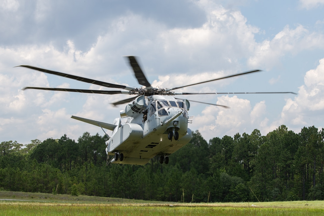 """U.S. Marine Corps Maj. Gen. Michael S. Cederholm flies the CH-53K """"King Stallion"""" at Marine Corps Base Camp Lejeune, North Carolina, June 12, 2021. Cederholm, the commanding general of 2nd Marine Aircraft Wing, said, """"the CH-53K is an awesome machine and will be an incredible asset to the (Marine Air Ground Task Force and joint force on the battlefield of the future."""" The CH-53K will replace the CH-53E """"Super Stallion,"""" which has served the Marine Corps for 40 years, and will transport Marines, heavy equipment and supplies during ship-to-shore movement in support of amphibious assault and subsequent operations ashore. 2nd Marine Aircraft Wing is the aviation combat element of II Marine Expeditionary Force. (U.S. Marine Corps photo by Cpl. Yuritzy Gomez)"""