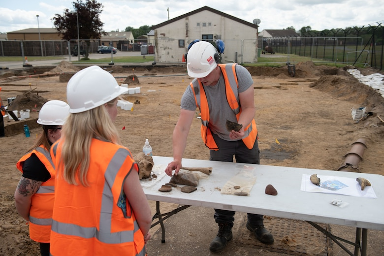 Michael Green, an archaeologist with Cotswold Archaeology, presents artifacts that were uncovered during an archaeological dig on Royal Air Force Lakenheath, England, June 10, 2021. Archaeologists are active team members during construction projects on base because of the abundance of history buried beneath the soil. (U.S. Air Force photo by Airman 1st Class Cedrique Oldaker)