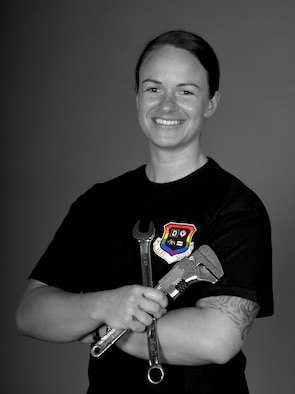 U.S. Air Force Master Sgt. Lyndsie Duemmel, 100th Force Support Squadron career assistance advisor, poses for a photo at RAF Mildenhall, England, June 28, 2021. Duemmel has been an aircraft maintainer throughout her military career and recently shared her personal LGBTQ+ story as part of Pride Month. (U.S. Air Force photo by Karen Abeyasekere)