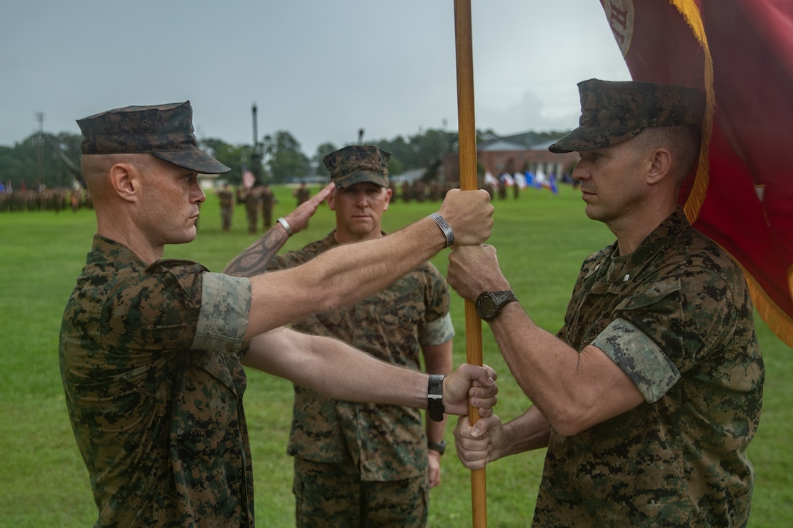 U.S. Marine Corps Lt Col. Richard J. Stinnett jr., right, relinquishes command of 1st Battalion, 10th Marine Regiment (1/10), 2d Marine Division, to Lt Col. William R. Soucie, left, during a change of command ceremony on Camp Lejeune, N.C., June 25, 2021. The ceremony represents the transfer of authority, responsibility, and accountability of 1/10 from the out-going commander with the incoming commander. (U.S. Marine Corps photo by Lance Cpl. Michael Virtue)