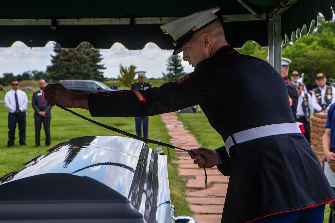 U.S. Marine Corps Sgt. Hunter Haffly, a squad leader with 1st Battalion, 6th Marine Regiment (1/6), 2d Marine Division, places a French Fourragere on the casket of U.S. Marine Corps Sgt. Donald D. Stoddard at Mountain View Memorial Park in Boulder, Colo., June 26, 2021. Stoddard died during the siege of Betio Island in November 1943 during World War II while assigned to 1/6. His remains were recovered in March 2019 by the non-profit organization, History Flight. (U.S. Marine Corps photo by Cpl. Chase W. Drayer)