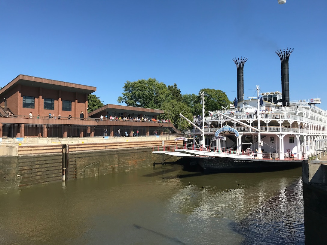 Visitors watch the American Queen lock through from the observation deck of the Illinois Waterway Visitor Center at Starved Rock Lock and Dam in Ottawa, Illinois.