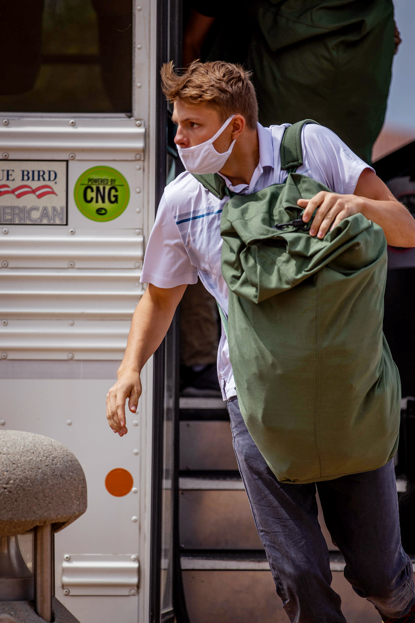 Recruit Lane Raney, a rct. with Delta Company, 1st Recruit Training Battalion, exits the bus during receiving at Marine Corps Recruit Depot, San Diego, June 22, 2021.
