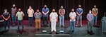 Capt. Jip Mosman, commander, Puget Sound Naval Shipyard & Intermediate Maintenance Facility, poses for a photo with some of the 31 2020 Employee of the Year award winners June 28, 2021, during an awards ceremony at the historic Admiral Theater in Bremerton, Washington. (PSNS & IMF photo by Scott Hansen)