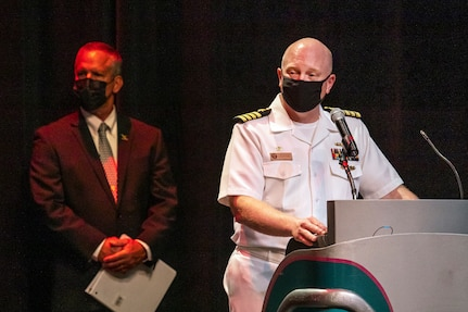 Capt. Jip Mosman, commander, Puget Sound Naval Shipyard & Intermediate Maintenance Facility, congratulates some of the 221 nominees for 2020 Employee of the Year during an award ceremony June 28, 2021, at the historic Admiral Theater in Bremerton, Washington. (PSNS & IMF photo by Scott Hansen)