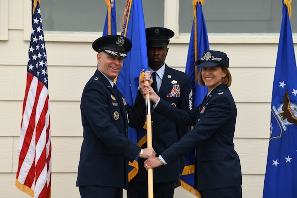 Maj. Gen. Michael Lutton, 20th Air Force commander, passes the guidon to Col. Catherine Barrington, 90th Missile Wing commander, during the 90 MW change of command ceremony June 28, 2021, F.E. Warren Air Force Base, Wyoming. The ceremony signified the transition of command from Col. Peter Bonetti to Col. Catherine Barrington. (U.S. Air Force photo by Airman 1st Class Anthony Munoz)