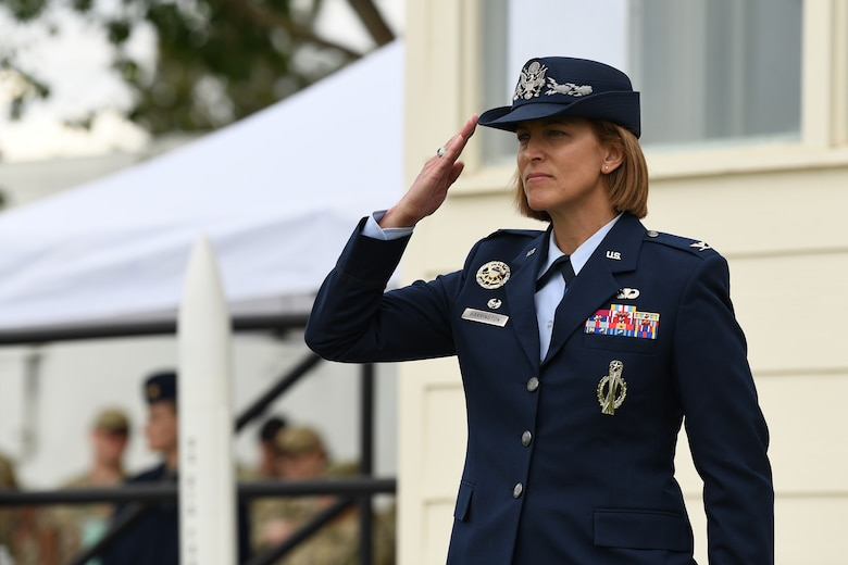 Col. Catherine Barrington, 90th Missile Wing commander, renders her first salute during the 90 MW change of command ceremony June 28, 2021, F.E. Warren Air Force Base, Wyoming. The ceremony signified the transition of command from Col. Peter Bonetti to Col. Catherine Barrington. (U.S. Air Force photo by Airman 1st Class Anthony Munoz)