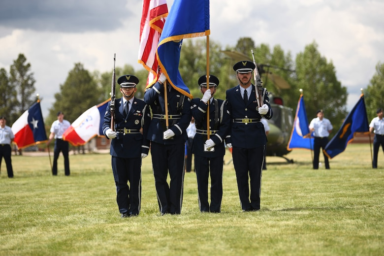 The honor guard stands in formation during the 90 MW change of command ceremony June 28, 2021, F.E. Warren Air Force Base, Wyoming. The ceremony signified the transition of command from Col. Peter Bonetti to Col. Catherine Barrington. (U.S. Air Force photo by Airman 1st Class Darius Frazier)