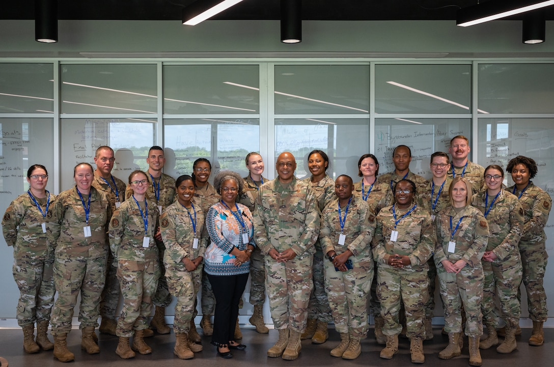 Lt. Gen. Anthony Cotton, Air Force Global Strike Command deputy commander, poses for a group photo with conference participants during the AFGSC Peer Influencer Conference at the Cyber Innovation Center in Bossier City, Louisiana, June 21, 2021. Victim advocates and peer influencers from installations across AFGSC came together to share ideas and best practices to tackle sexual assault prevention and response. (U.S. Air Force photo by Airman 1st Class Jonathan E. Ramos)