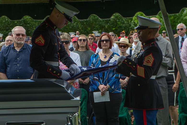 U.S. Marine Corps Cpl. Draxxon Lell (left) and U.S. Marine Gunnery Sgt. Marcus Reeves (right), both with Combat Logistics Battalion 453, 4th Marine Logistics Group, customarily fold the American flag during U.S. Marine Corps Sgt. Donald D. Stoddard's funeral at Mountain View Memorial Park in Boulder, Colo., June 26, 2021. Stoddard died during the siege of Betio Island in November 1943 during World War II while assigned to 1st Battalion, 6th Marine Regiment, 2d Marine Division. His remains were recovered in March 2019 by the non-profit organization, History Flight. (U.S. Marine Corps photo by Cpl. Chase W. Drayer)