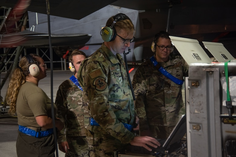 The Combat Shield members look at the data from the Radar Warning Receiver.
