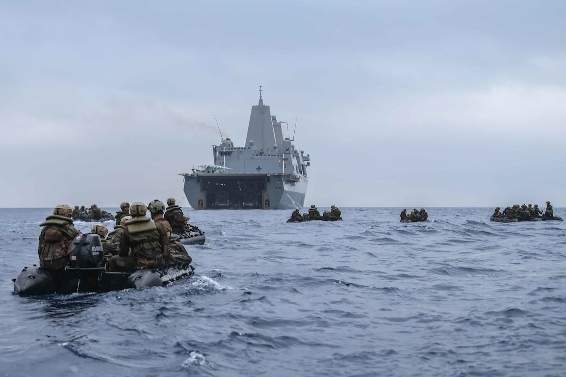 Marines with Battalion Landing Team 3/5, 31st Marine Expeditionary Unit, prepare to board the amphibious assault ship USS New Orleans (LPD 18) after executing an amphibious raid rehearsal in the Philippine Sea, June 17, 2021. Marines with the 31st MEU conduct amphibious raid rehearsals in order to test maritime readiness, refine standard operating procedures, and sustain proficiency in small boat handling fundamentals. The 31st MEU is operating aboard ships of the America Amphibious Ready Group in the 7th fleet area of operations to enhance interoperability with allies and partners, and serve as a ready response force to defend peace and stability in the Indo-Pacific region.