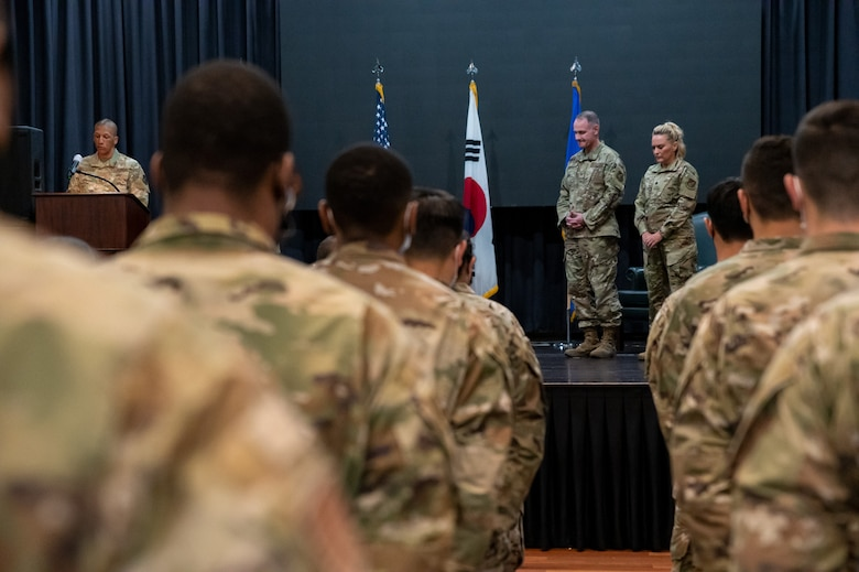 Chaplain Christopher Crutchfield, left, performs an invocation at the 51st Operational Medical Readiness Squadron assumption of command at Osan Air Base, Republic of Korea, June 29, 2021. The change of command ceremony is deeply rooted in military tradition that dates back to the reign of King Frederick of Prussia and has persisted into modern day. (U.S. Air Force photo by Tech. Sgt. Nicholas Alder)
