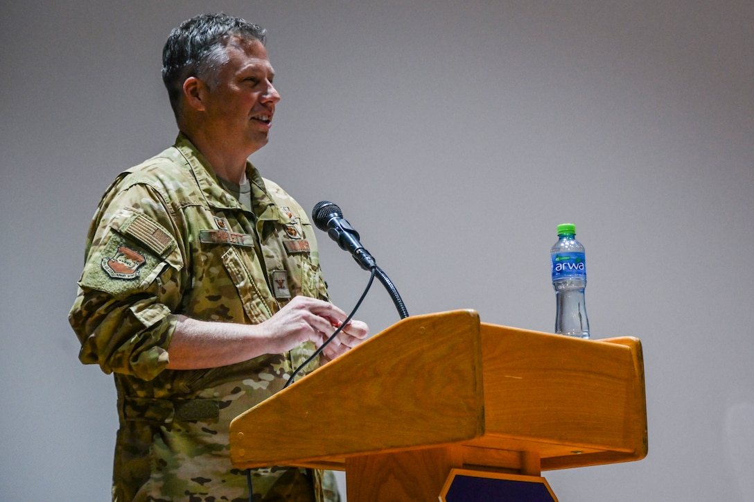 A photo of a commander speaking at a ceremony