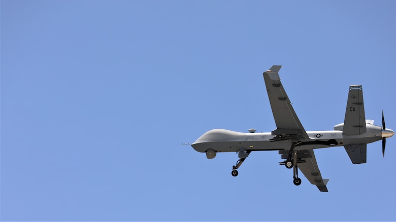 California Air National Guard's 163d Attack Wing MQ-9 Reaper remotely piloted aircraft takes off from a runway at March Air Reserve Base in Moreno Valley, California before mapping a controlled fire, June 9, 2021. (U.S. Army National Guard illustration by Sgt. 1st Class Amanda H. Johnson)