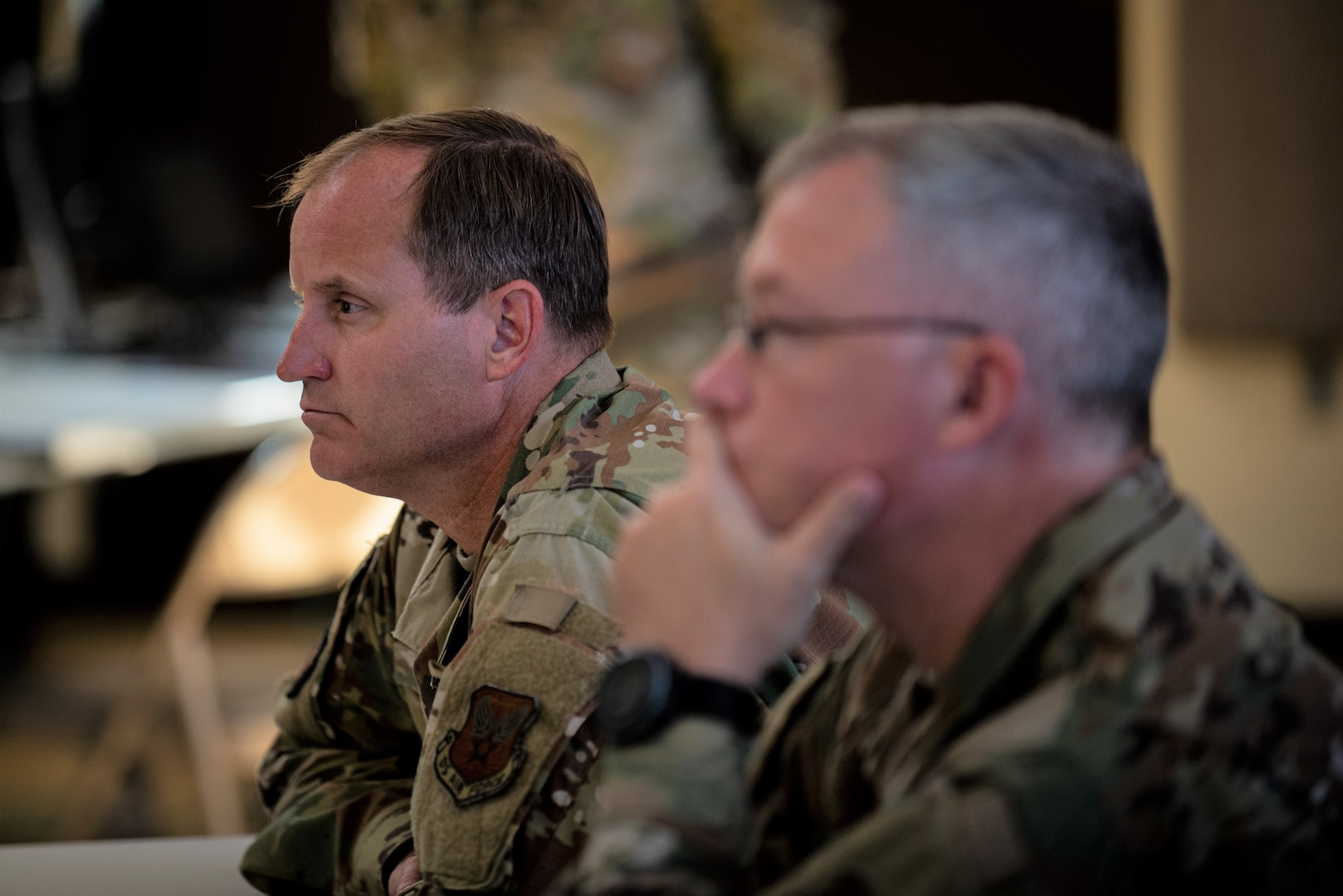 Air Force contracting leaders listen to a briefing