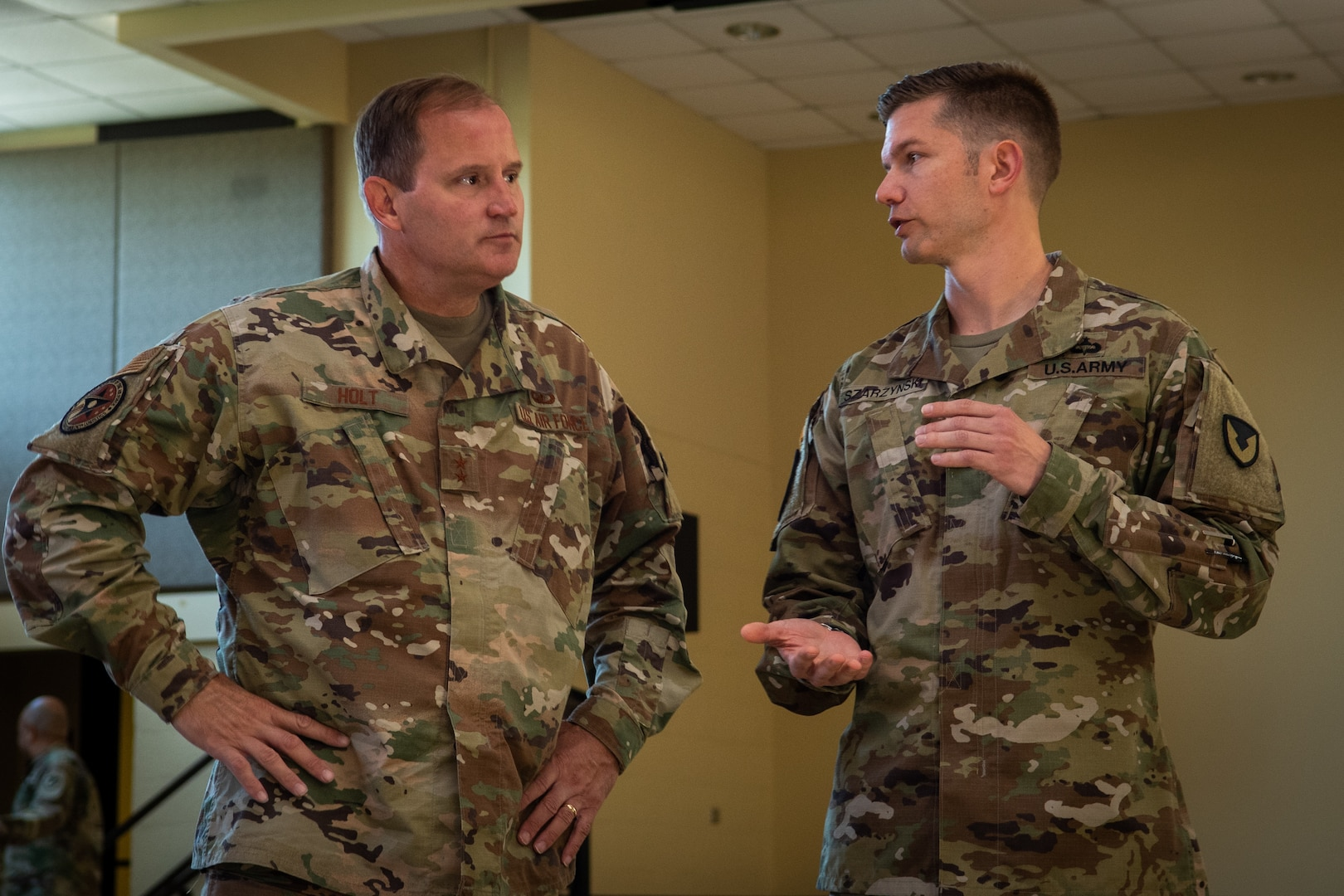 Air Force Maj. Gen. Cameron Holt talks with Army Maj. Matthew Szarzynski