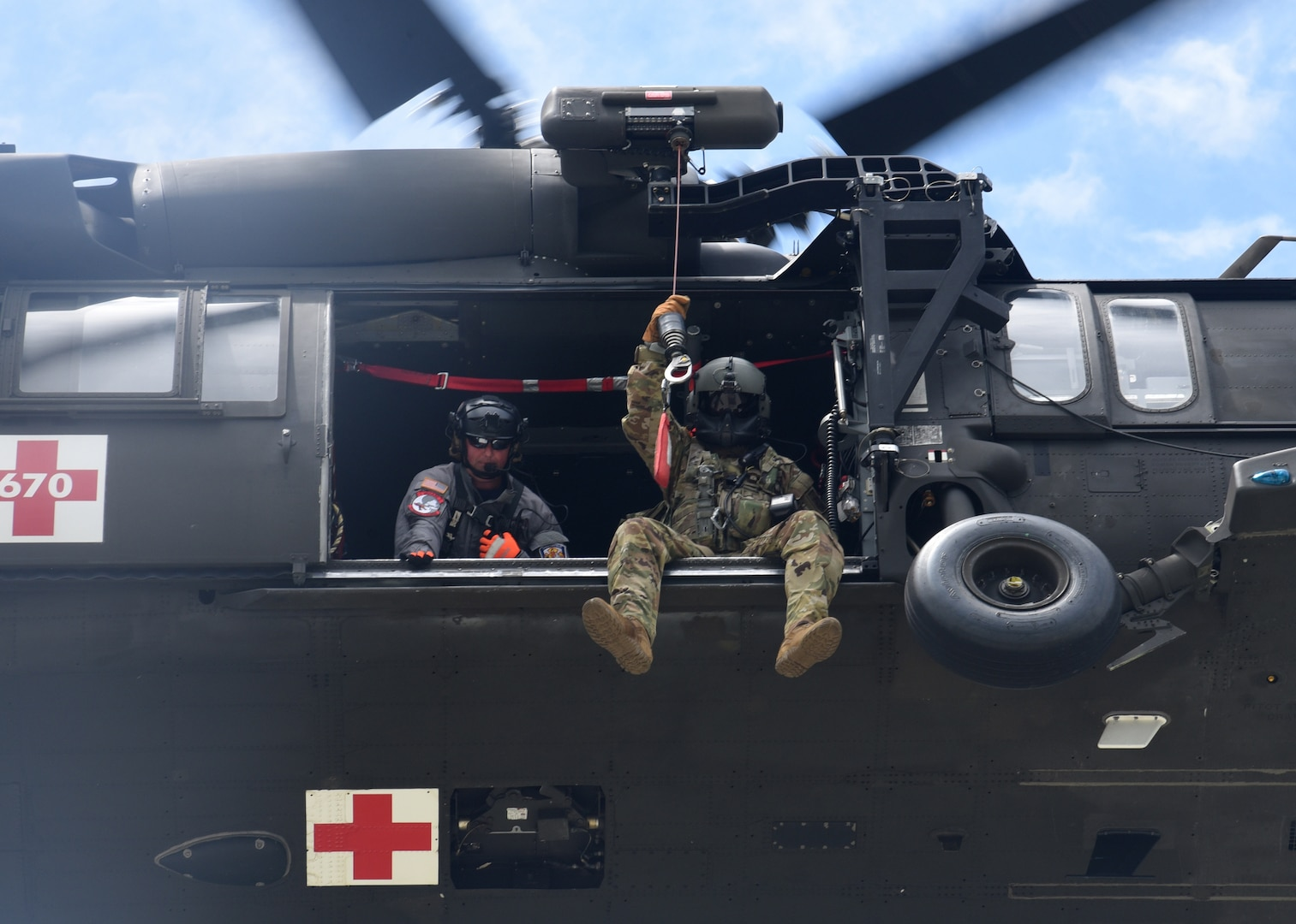 Virginia National Guard aviation crews and Chesterfield County Fire and Emergency Medical Services Scuba Rescue Team members train on confined-space rescue hoist operations June 10, 2021, in Chesterfield County, Virginia.