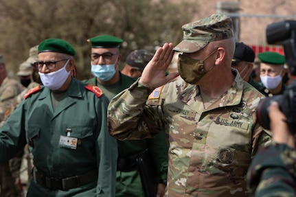 U.S. Army Maj. Gen. Michael Turley, adjutant general, Utah National Guard, salutes U.S. and Moroccan Armed Forces members during a key leader engagement as part of African Lion 2021 June 16, 2021, at the Military Medical Surgical Field Hospital in Tafraoute, Morocco. Utah and Morocco are partners under the State Partnership Program.